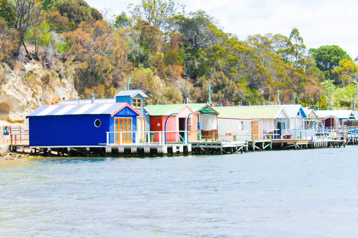 Colourful boathouses Architecture Blue Boathouse Row Boathouses Building Exterior Built Structure Calm Day House Lake Mountain Nature No People Outdoors Rippled Riverbank Scenics Sea Town Tranquil Scene Tranquility Tree Water Waterfront