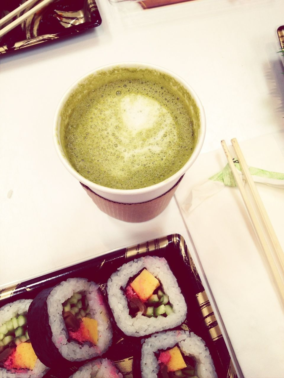 High Angle View Of Soup With Sushi Served On Table