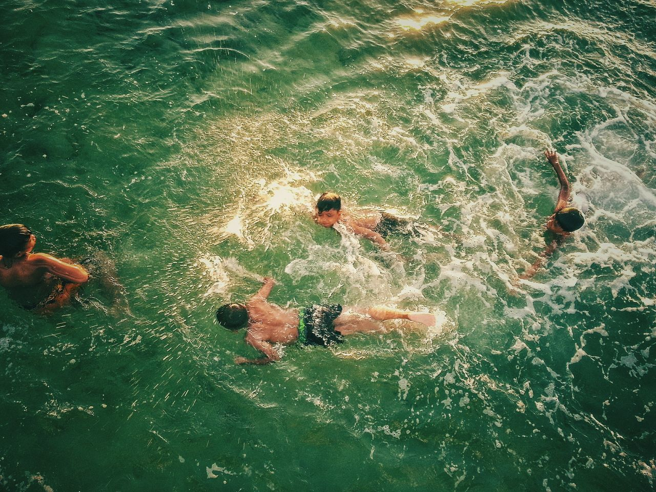 water, swimming, high angle view, real people, swimming pool, day, nature, shirtless, leisure activity, outdoors, lifestyles, sea