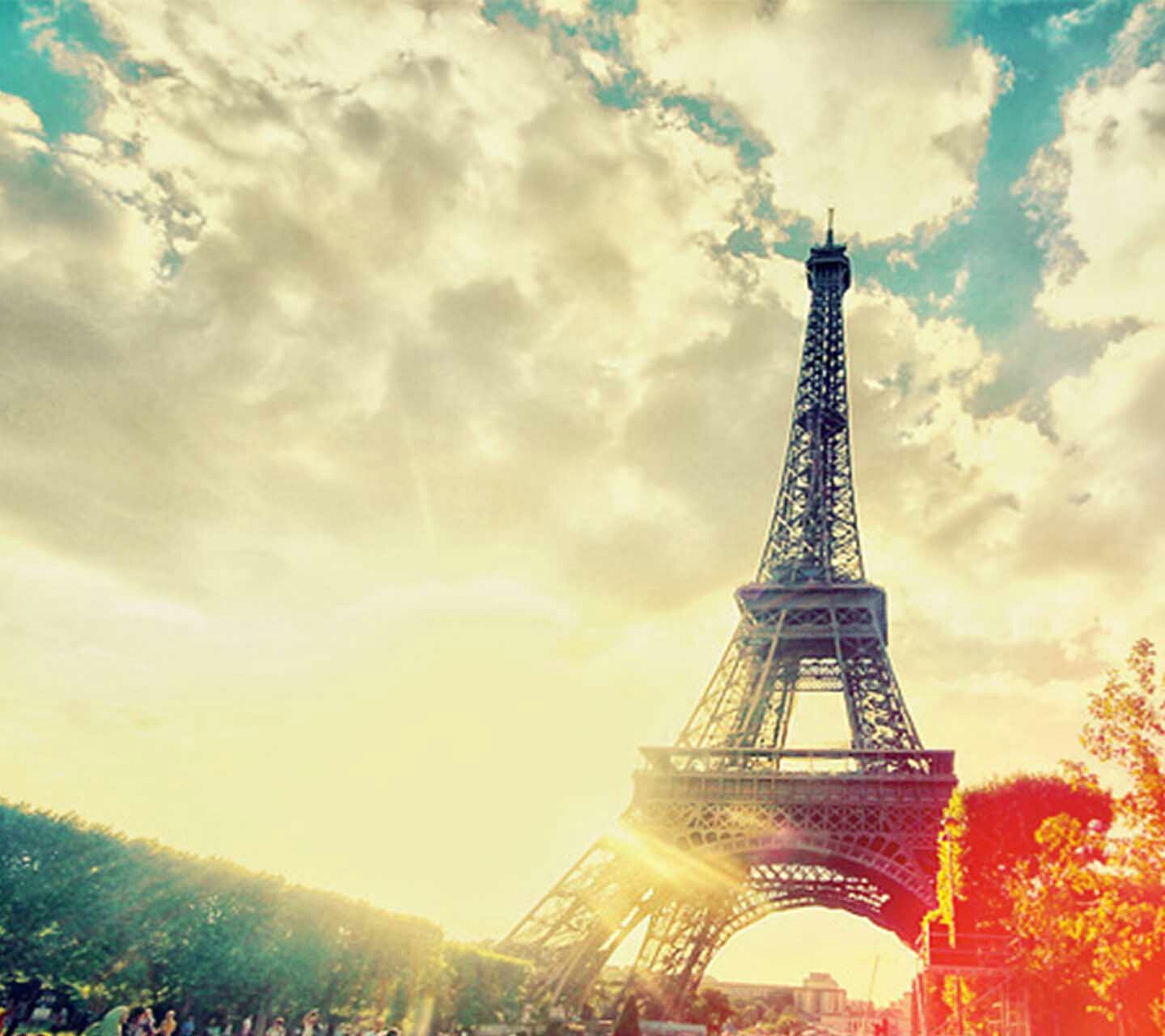 tourism, travel destinations, famous place, international landmark, eiffel tower, tower, travel, capital cities, built structure, architecture, culture, cloud - sky, tall - high, city, sky, metal, spire, architectural feature, iron - metal, outdoors, cloud, tall, cloudy, history, day, nature, 19th century style, scenics, monument