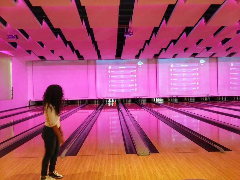 Time to bowling. Illuminated Neon Pink Color One Person Neon Colored Bowling Bowling Alley Bowling Ball Bowling Pins Light Screens Colorful Funny Game Strike Millennial Pink