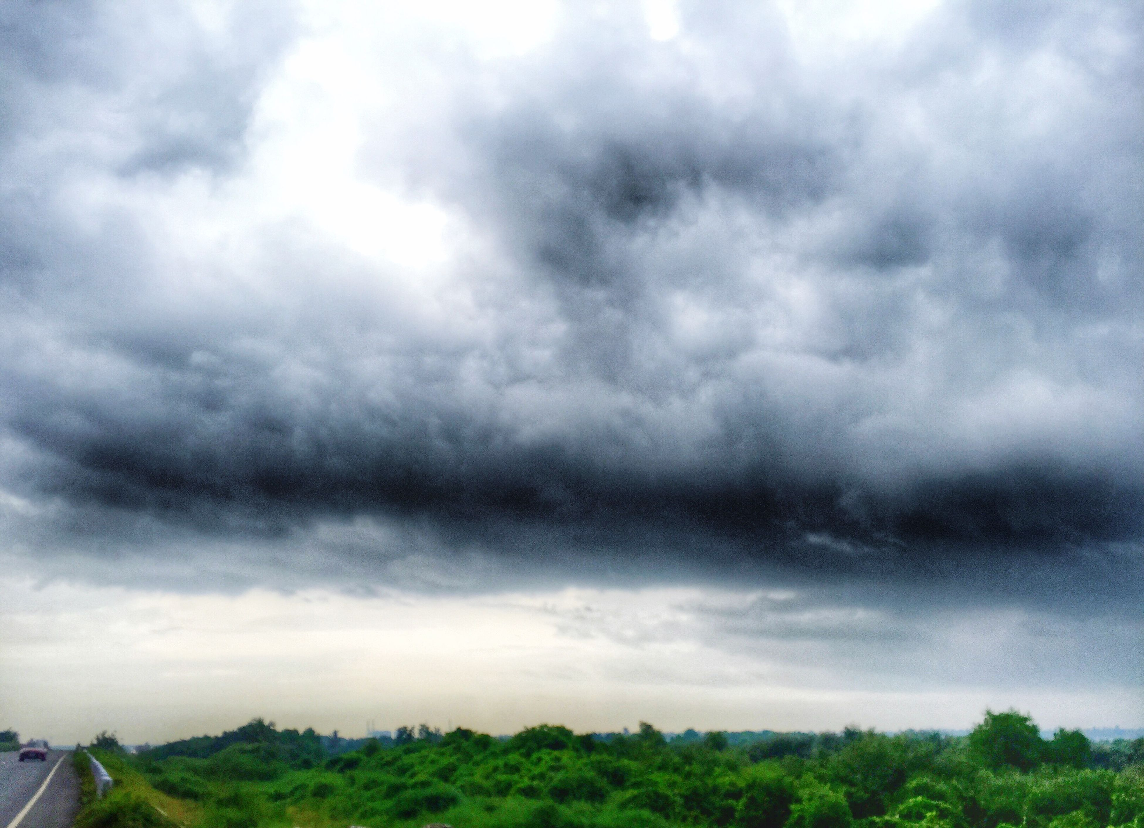 sky, cloud - sky, cloudy, tranquil scene, landscape, tranquility, scenics, beauty in nature, nature, cloud, field, grass, weather, overcast, tree, day, growth, idyllic, non-urban scene, cloudscape