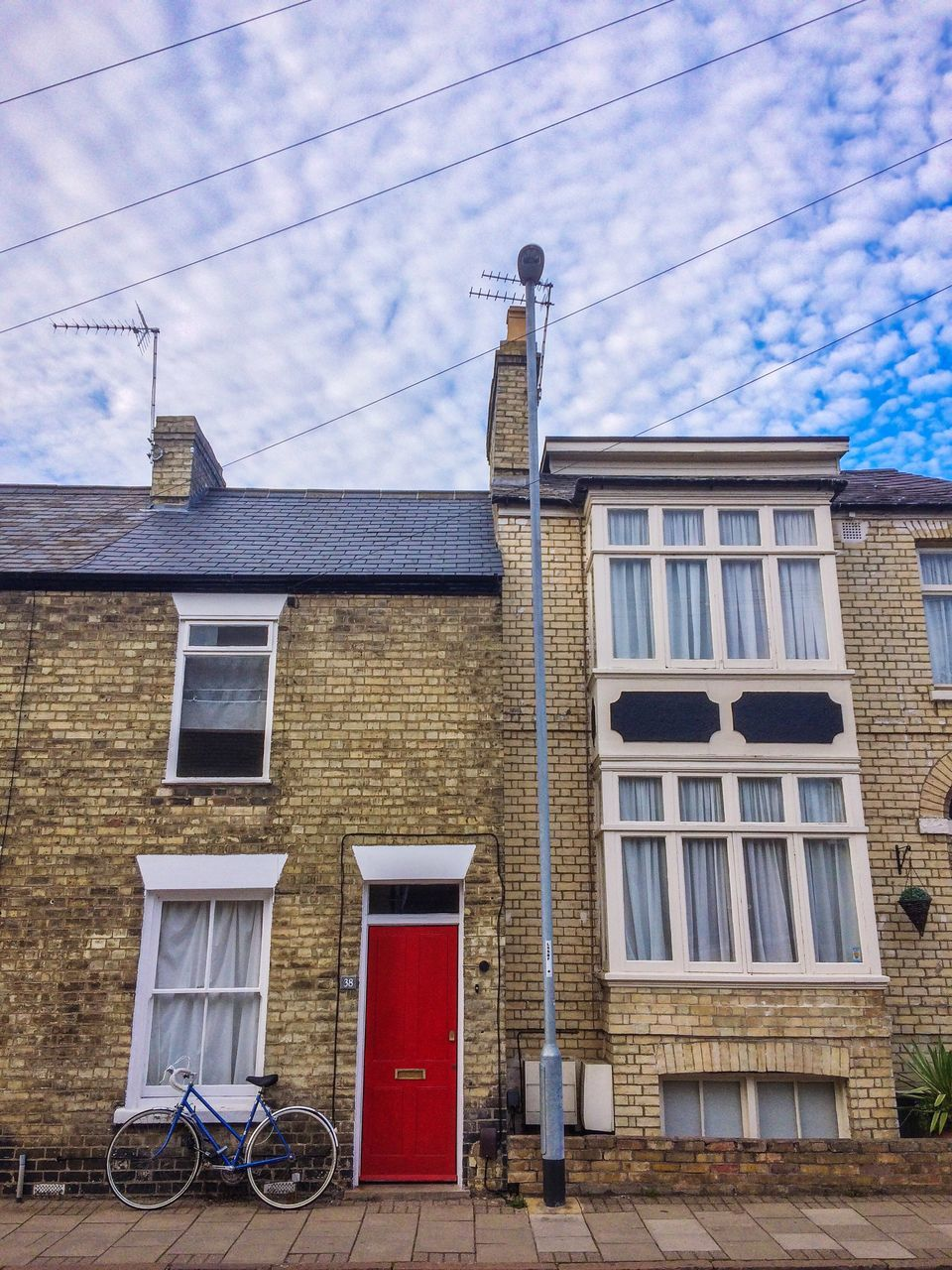 building exterior, architecture, built structure, window, sky, cloud - sky, outdoors, house, day, no people