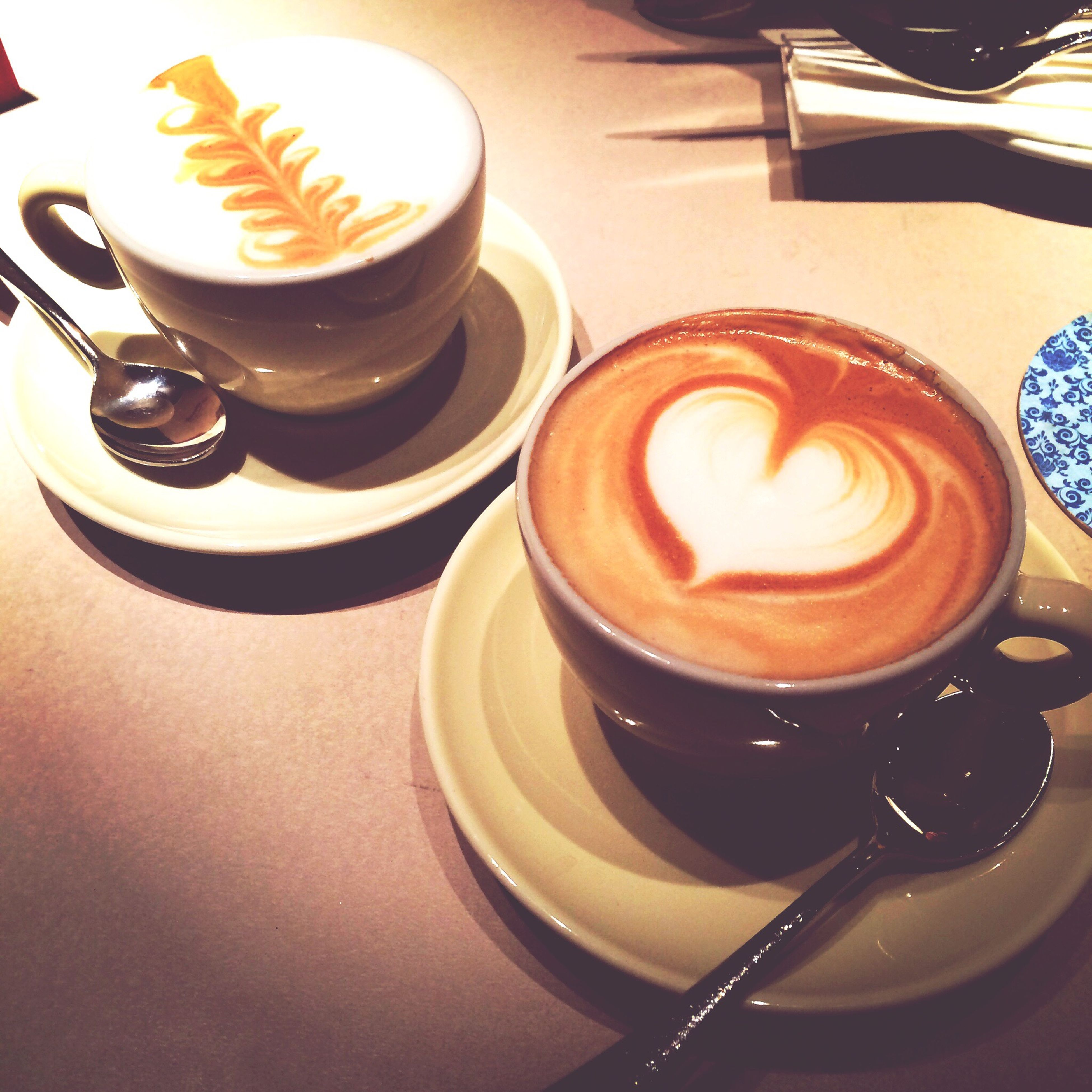 coffee cup, food and drink, indoors, drink, coffee - drink, saucer, refreshment, table, freshness, still life, frothy drink, cappuccino, coffee, cup, high angle view, froth art, spoon, close-up, sweet food, no people