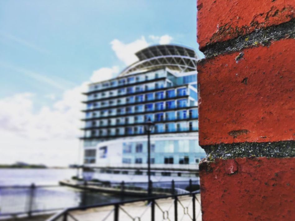 Bricks and Design Architecture Building Building Exterior Building Story Buildings Built Structure Cardiff Bay Cloud - Sky Focus On Foreground High Section Hot Industrial No People Outdoors Sky St David's Water