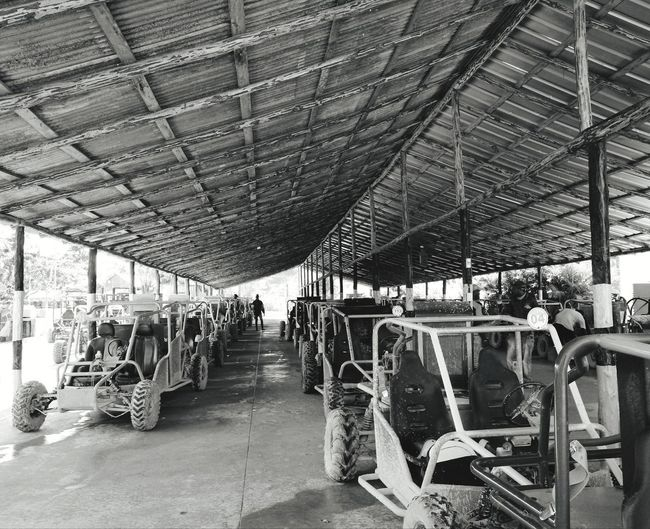 dune buggy garage Vacation Holiday Blackandwhite Monochrone Contrast Dominican Republic Dune Buggy Garage Large Group Of Objects Indoors  Transportation Day Hanging