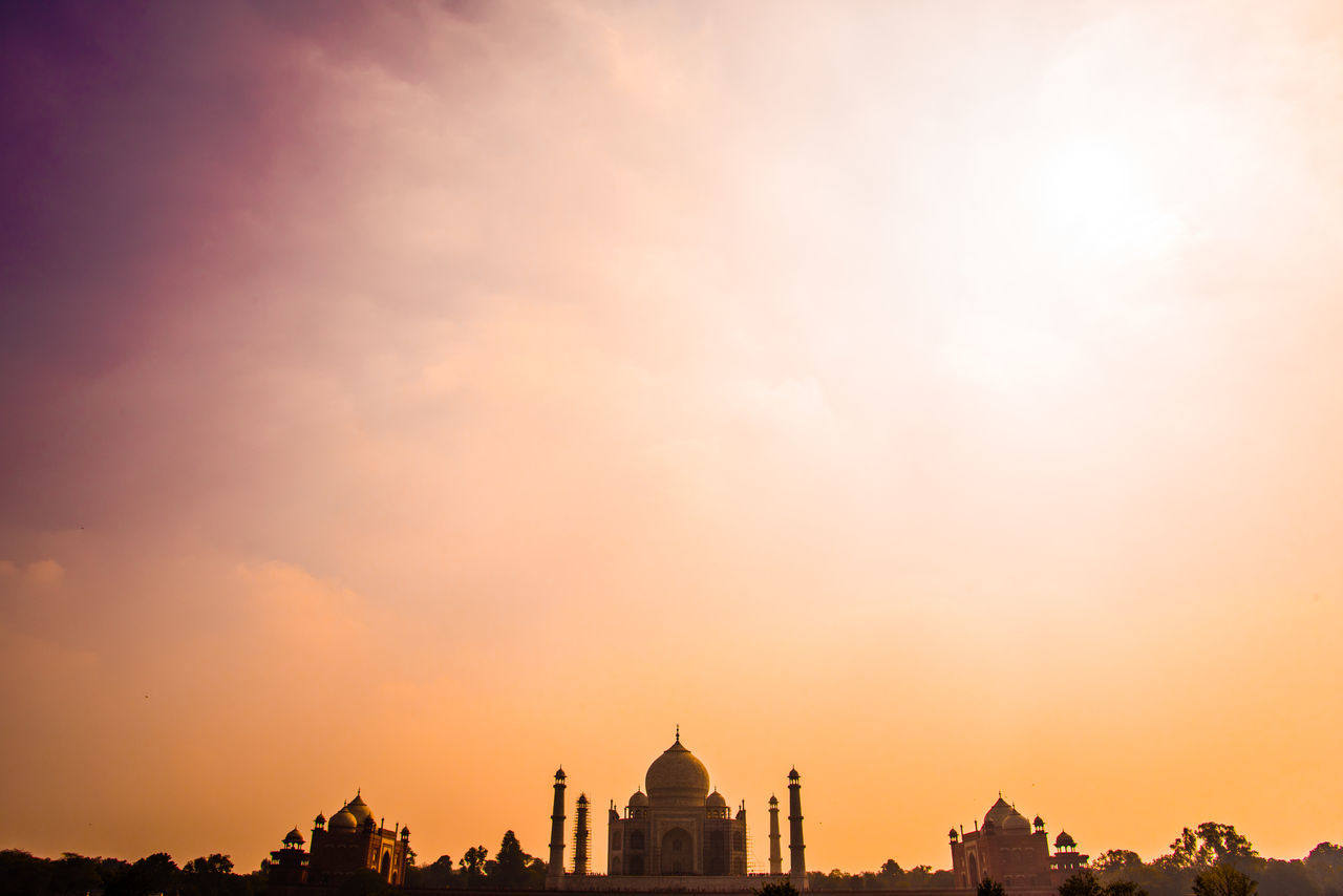 Low Angle View Of Taj Mahal Against Cloudy Sky During Sunset