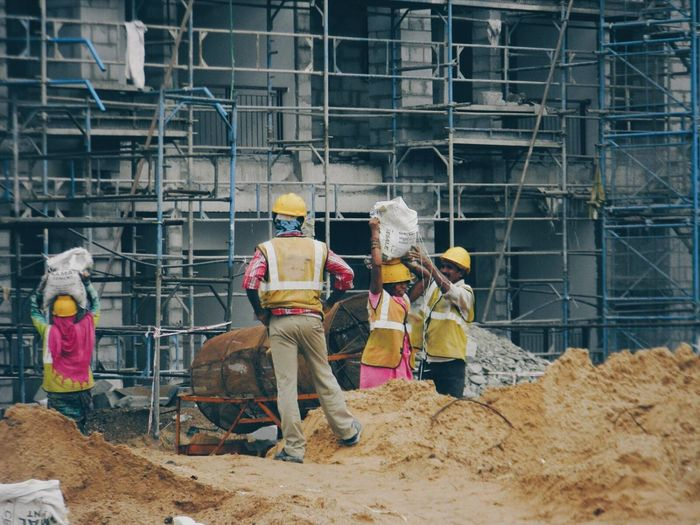 Men Togetherness Working Full Length Manual Worker Water Worker Occupation Holding Teamwork Industry Person Day Casual Clothing Outdoors Working Hard Construction Site Workers At Work People Together Bars And Pipes Two Is Better Than One