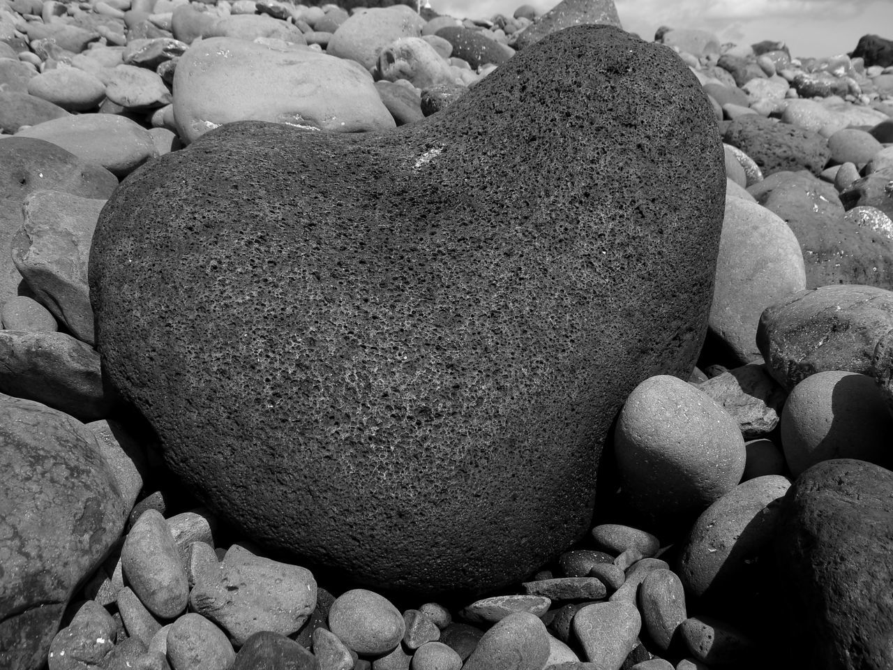 Heart shaped pebble on the beach of Canico on the island of Madeira. Beach Black Black And White Close-up Day Heart Shape Heart ❤ Lonely Heart Nature No People Outdoors Pebble Pebbles On A Beach Round Shape Stone - Object
