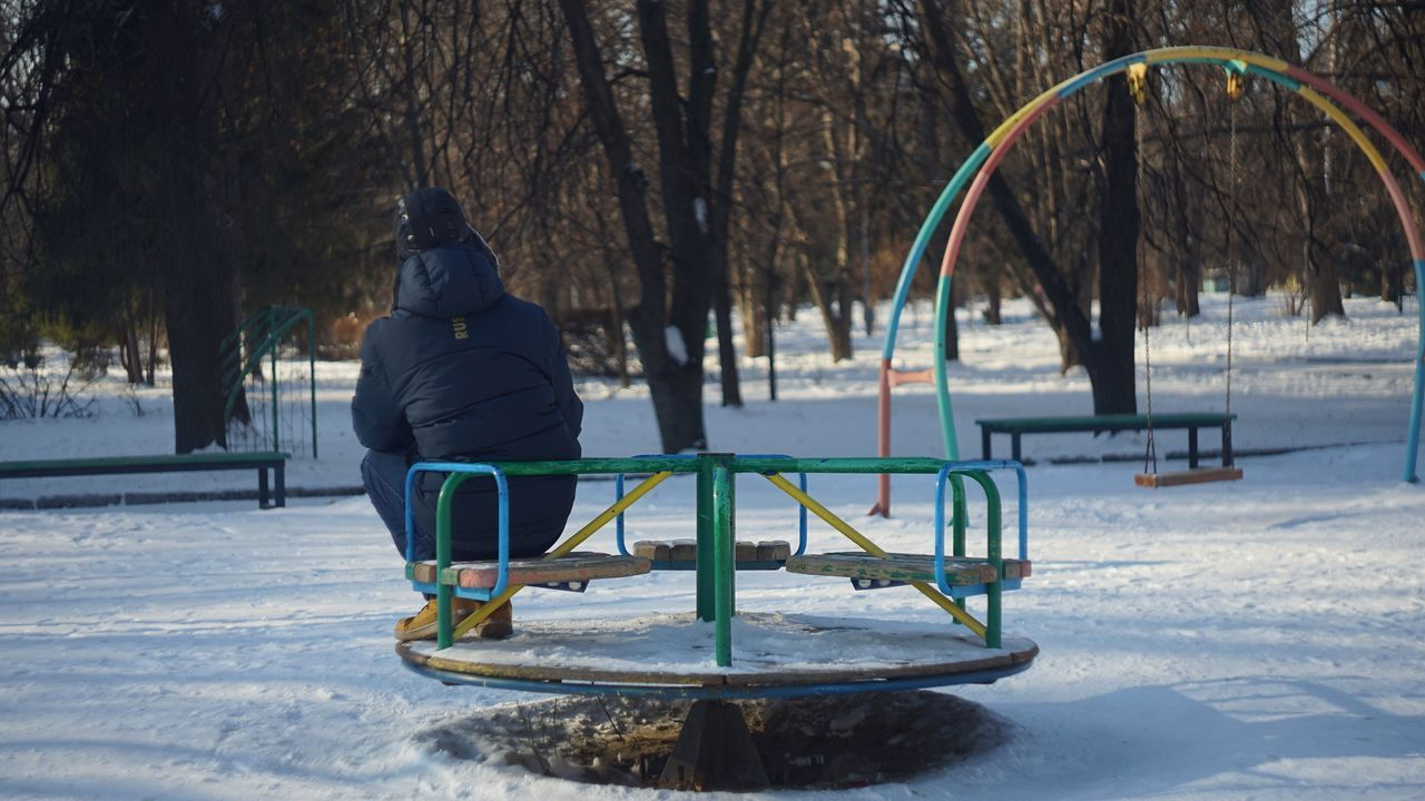 winter, cold temperature, snow, tree, real people, weather, nature, full length, leisure activity, childhood, outdoors, one person, playground, park - man made space, day, warm clothing, lifestyles, beauty in nature