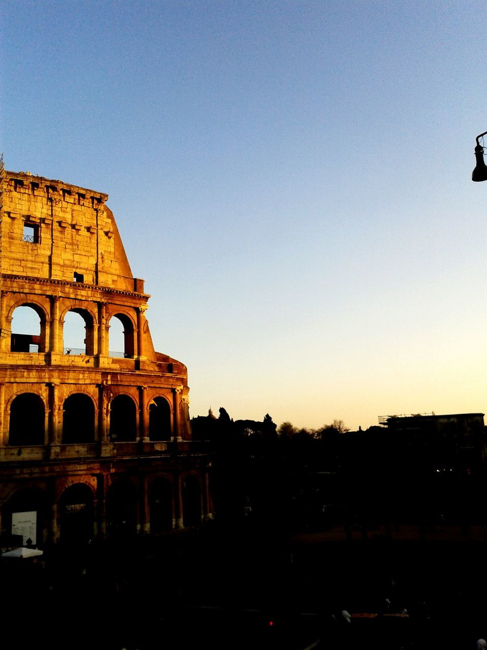 built structure, architecture, copy space, history, clear sky, ancient, travel destinations, building exterior, outdoors, arch, tourism, sunset, old ruin, sky, ancient civilization, no people, nature, day