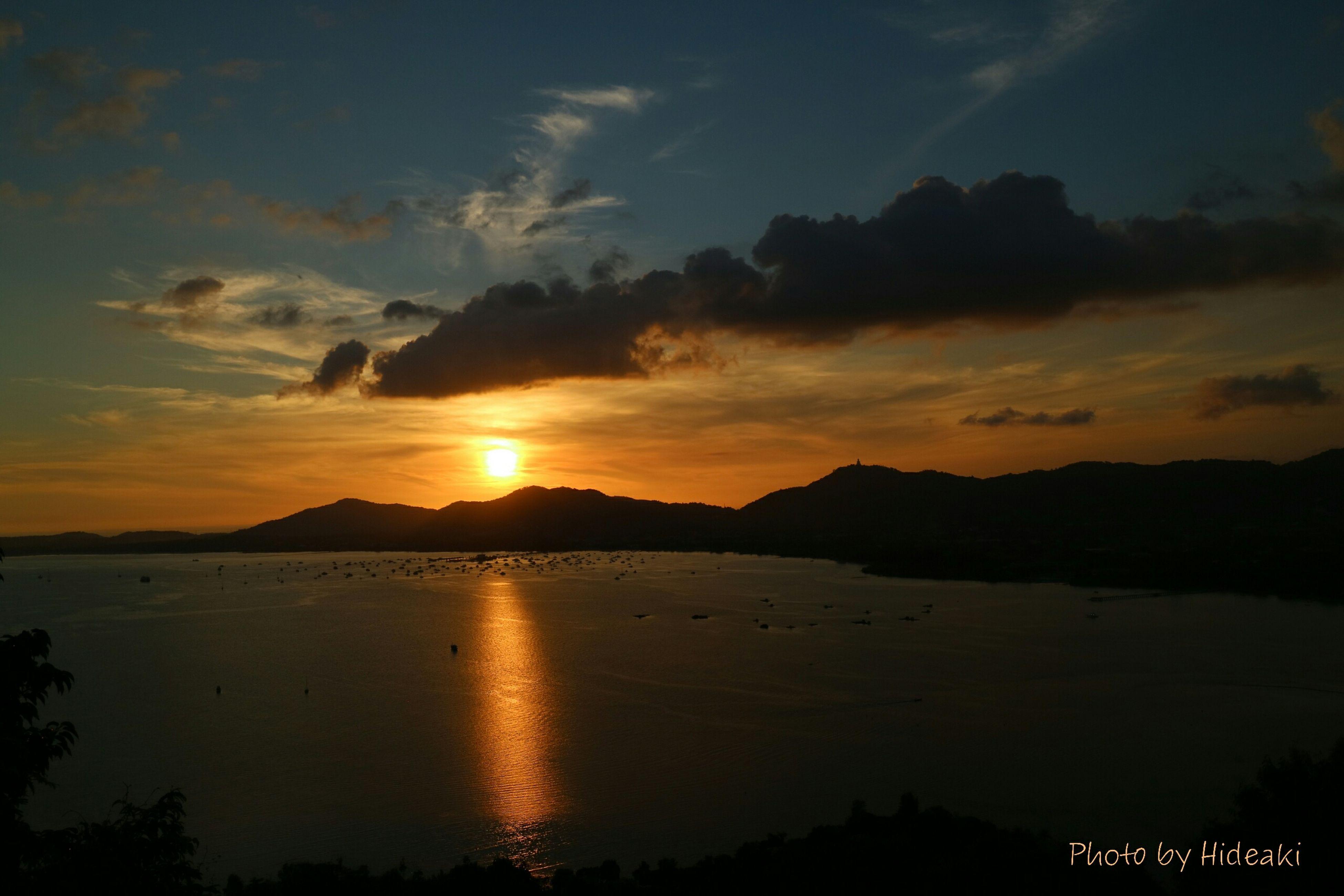 sunset, water, scenics, tranquil scene, mountain, sky, beauty in nature, tranquility, silhouette, sun, cloud - sky, idyllic, reflection, mountain range, nature, orange color, sea, lake, cloud, sunlight