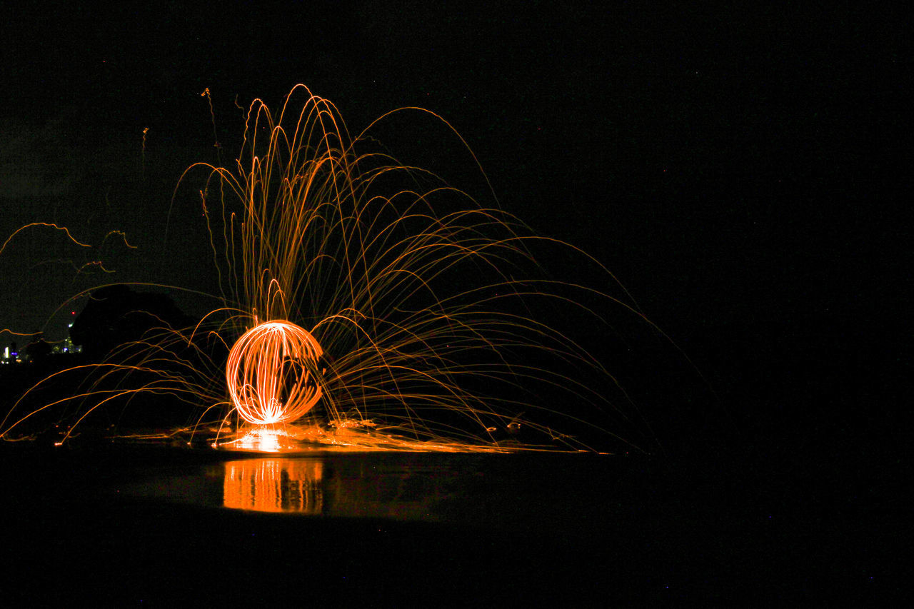 steel wool spinning Arts Culture And Entertainment Blurred Motion Exploding Long Exposure Motion Night No People Outdoors Reflection Sparks Steel Wool Steelwool Steelwoolphotography Water Wire Wool