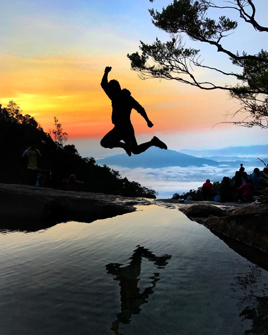 jumping, mid-air, full length, silhouette, water, sunset, energetic, one person, sea, real people, leisure activity, motion, outdoors, men, sky, nature, excitement, stunt, day, people