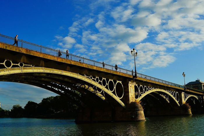 Triana bridge Bridge Triana Triana Bridge Bridge - Man Made Structure Architecture Connection Arch Built Structure Low Angle View Transportation Sky River Water Day Outdoors