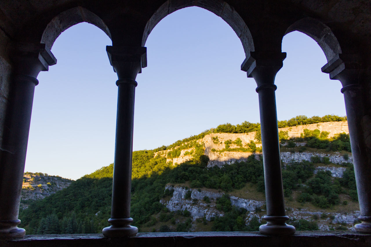 Arch Architectural Column Architecture Built Structure Clear Sky Cloister Cultures Golden Hour Historical Place History Nature Ornamental Garden Rocamadour Rock Formation Sky Sunset Symetry Tree