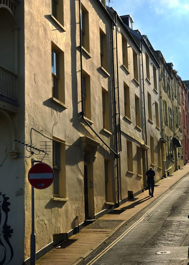 Building Exterior Architecture Built Structure Window Outdoors Sunlight Shadow Road City Day One Person Old Buildings Old House Oldtown Steep Hill Steep Slope Streetphotography Street Street Photography Streetphoto_color Street Life Streetphoto Houses Houses And Windows House
