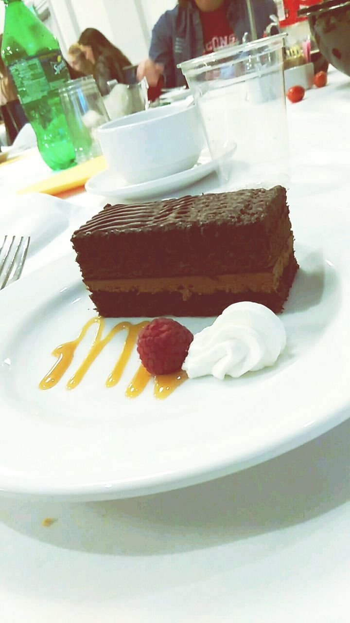 food and drink, sweet food, plate, cake, indulgence, dessert, food, temptation, unhealthy eating, freshness, ready-to-eat, table, indoors, serving size, close-up, selective focus, food styling, gourmet, slice, dessert topping, cream, cheesecake, no people, day