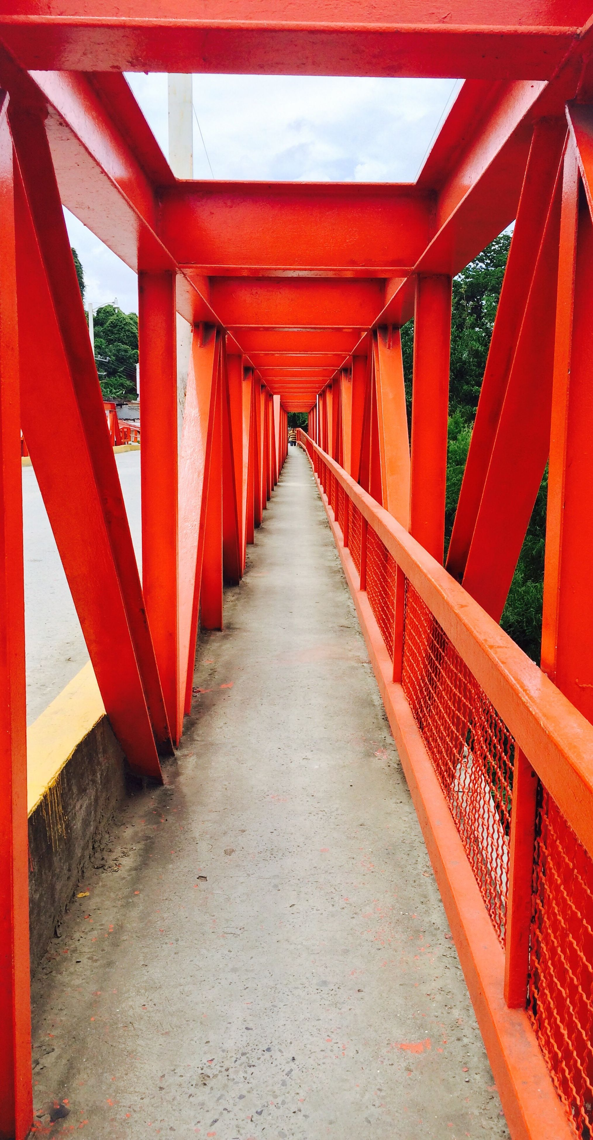 the way forward, architecture, built structure, diminishing perspective, narrow, long, bridge - man made structure, red, footbridge, connection, ceiling, walkway, elevated walkway, corridor, surface level, day, vanishing point, modern, covered bridge, architectural column, bridge, no people, pedestrian walkway