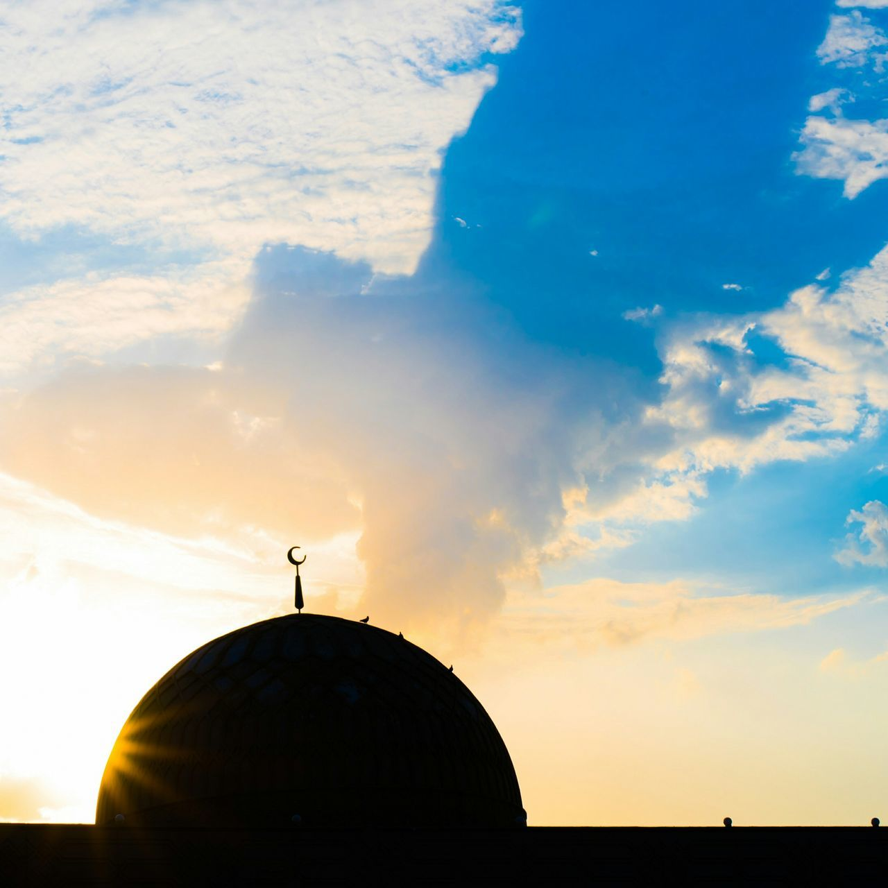 Low Angle View Of Silhouette Mosque Dome Against Sky