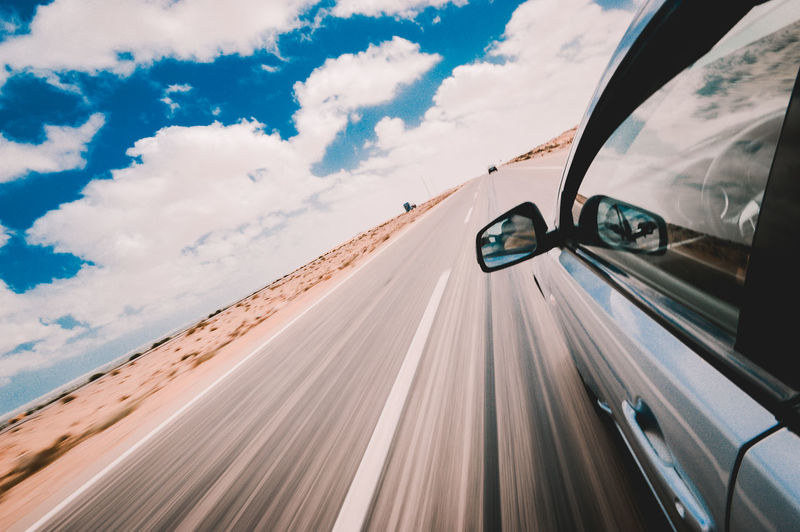 Blue Car Clouds Day Desert Destination Egypt Highway Journey Land Vehicle Motion Nature Outdoors Road Road Trip Sky Speed Transportation Travel Vacations First Eyeem Photo