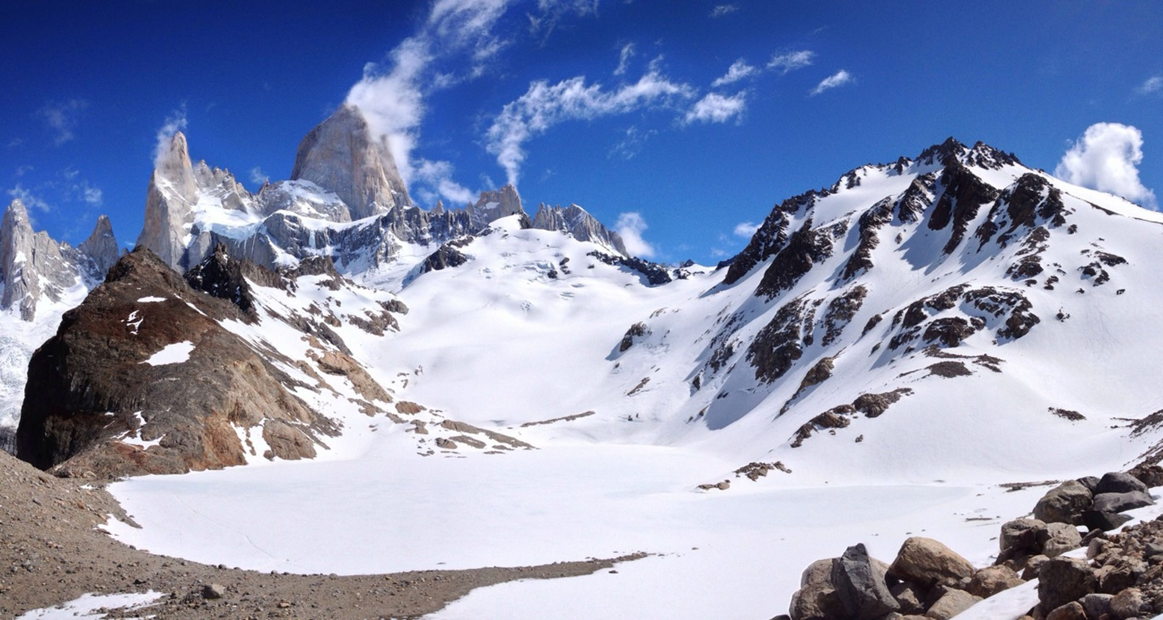snow, mountain, cold temperature, winter, mountain range, snowcapped mountain, season, tranquil scene, sky, tranquility, beauty in nature, scenics, nature, weather, blue, landscape, rock - object, rocky mountains, non-urban scene, sunlight