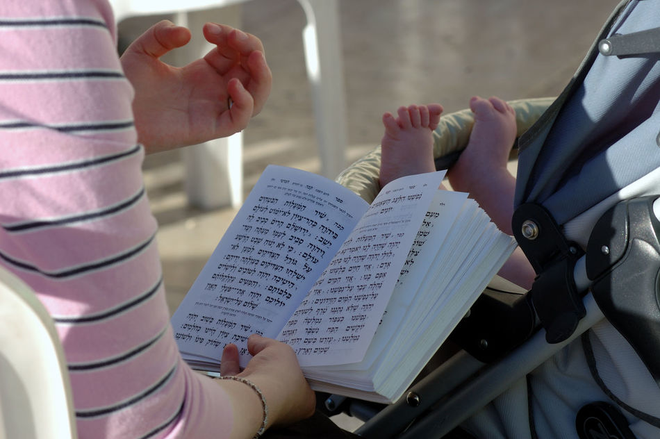 Holy hands and baby feet praying from the jewish holy book Baby Feet Cute Feet Hands Holy Book Human Body Part Human Hand Jerusalem Jew Jewish Jewish Holiday Jewish Praying Jewish Religion Jewry Praying Time Reading A Book Real People Religion Religion And Beliefs Religion And Faith Wailing Wall