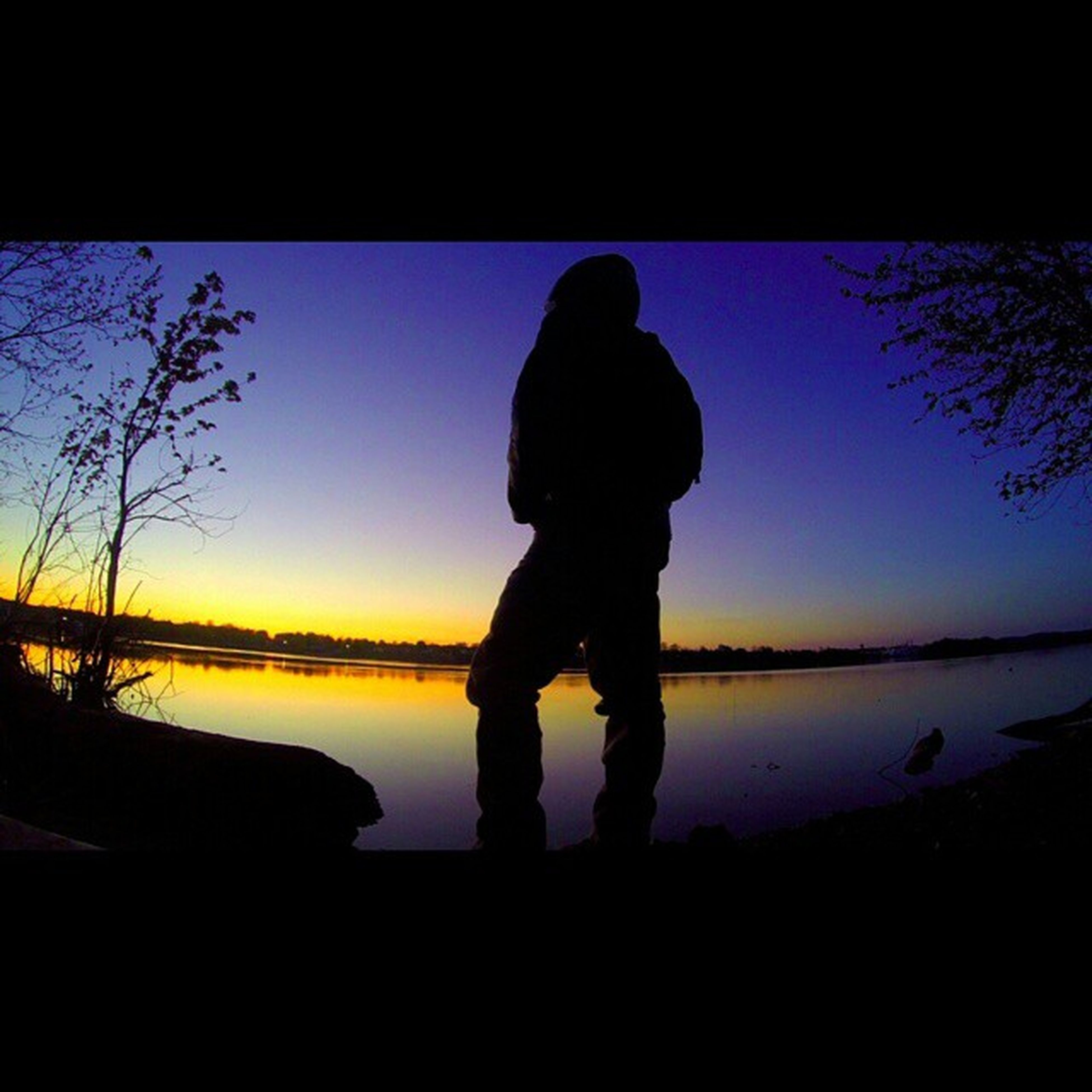 silhouette, water, lifestyles, leisure activity, rear view, full length, standing, sunset, sky, childhood, men, clear sky, sea, tranquility, lake, nature, person, tree