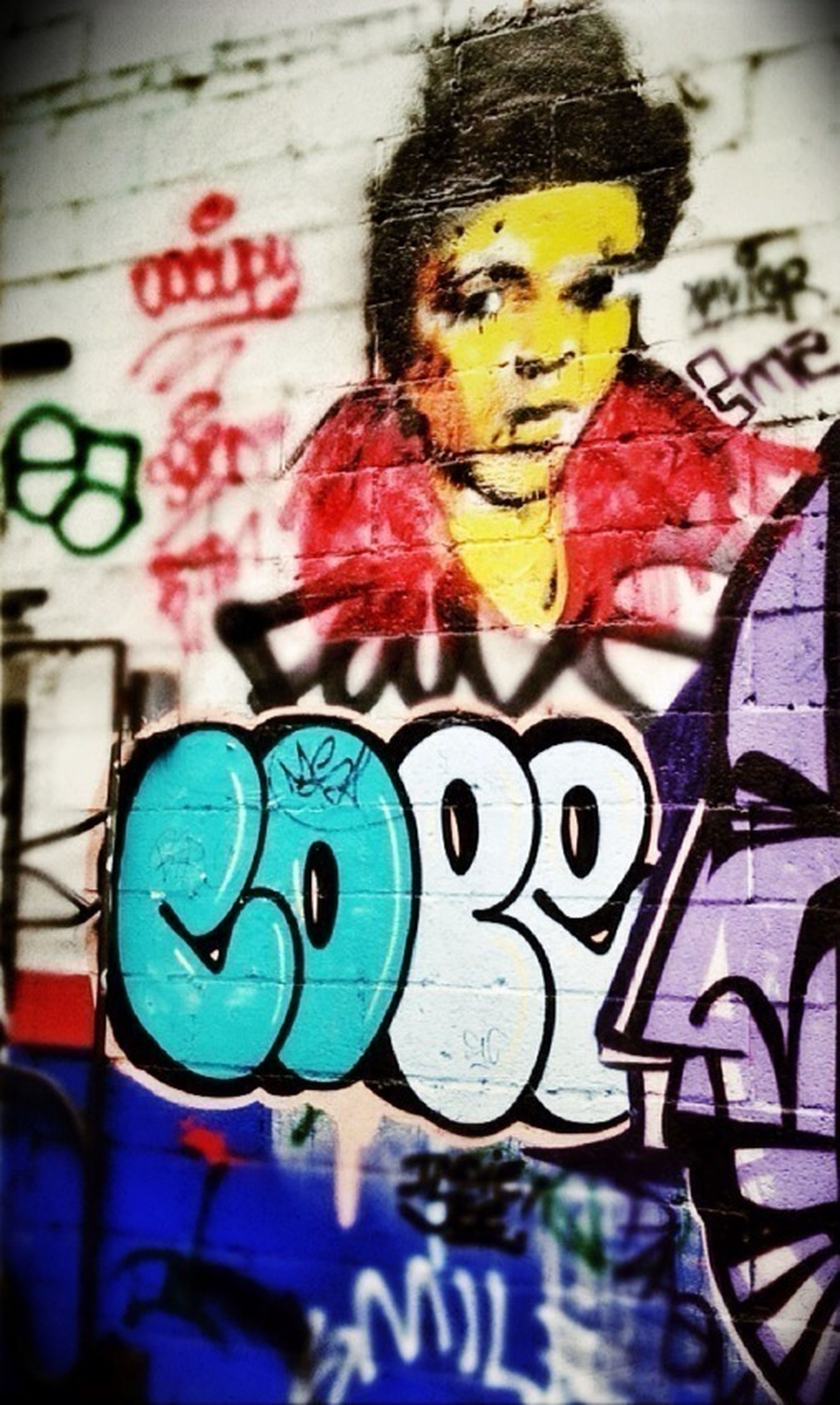 graffiti, art, creativity, art and craft, text, human representation, wall - building feature, communication, western script, indoors, close-up, multi colored, built structure, architecture, street art, wall, painting, day