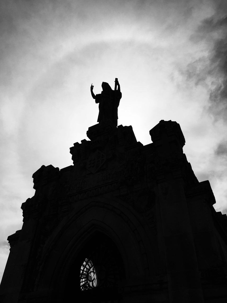 statue, sculpture, low angle view, human representation, art and craft, silhouette, architecture, cloud - sky, built structure, creativity, building exterior, sky, outdoors, history, arch, day, travel destinations, no people