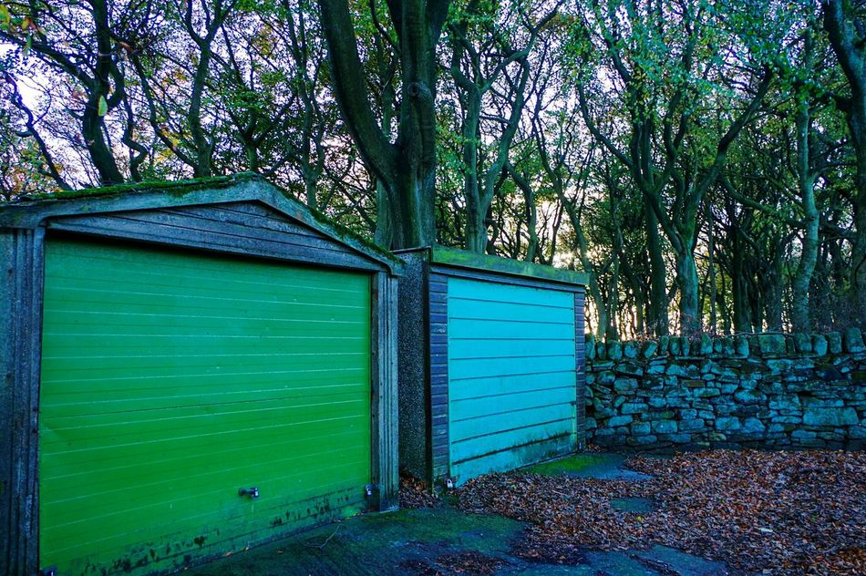 No People Blue Nature Scenics Tree Beauty In Nature Built Structure Outdoors Day Green Color Tranquility Sky Garages Architecture Green Garage Doors Beautifully Organized Landscape Pattern Beauty In Nature Rainbow Nature On Your Doorstep Yorkshire Calderdale Woodlands