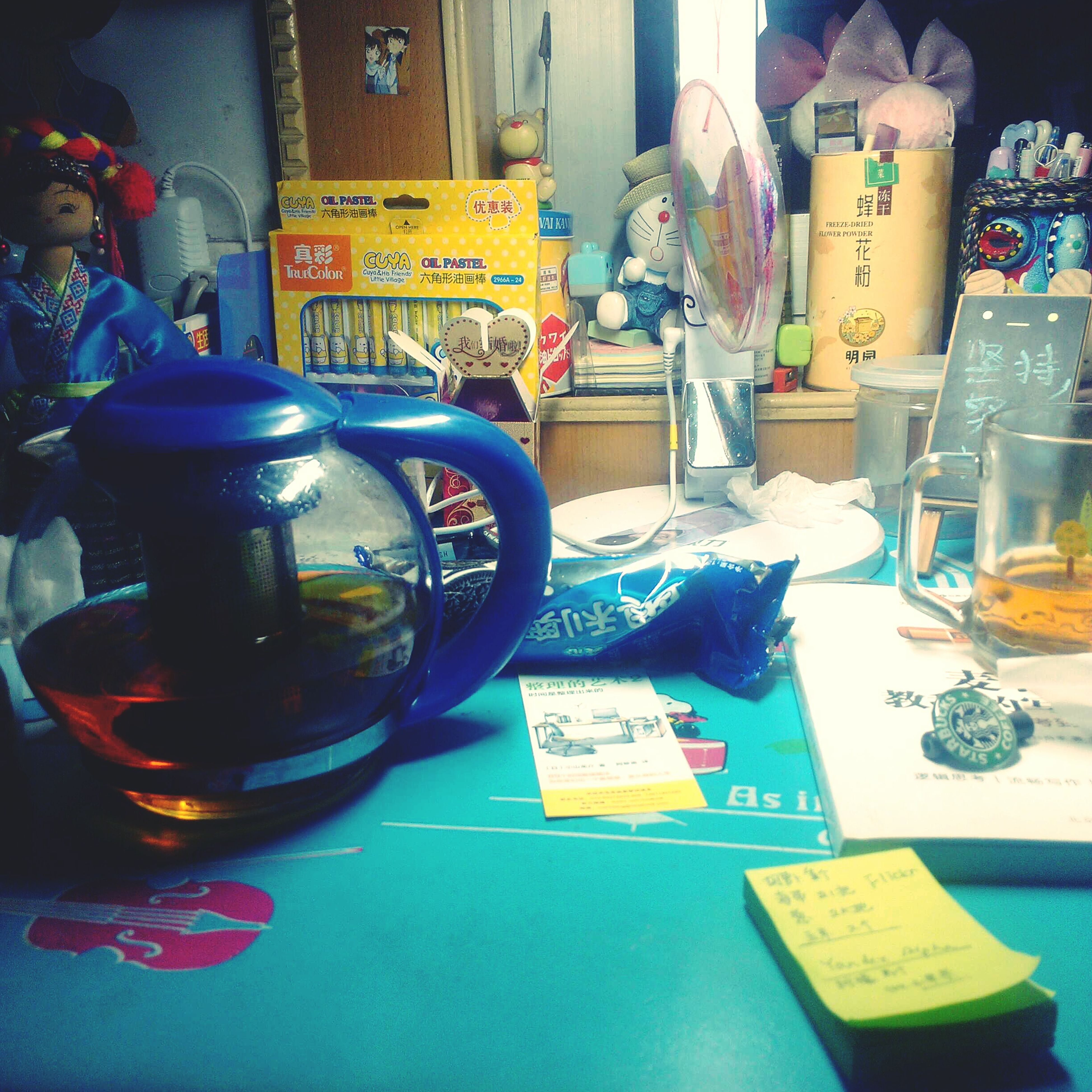 indoors, still life, table, variation, food and drink, bottle, drink, close-up, no people, multi colored, glass - material, jar, drinking glass, container, choice, large group of objects, home interior, blue, plastic, refreshment