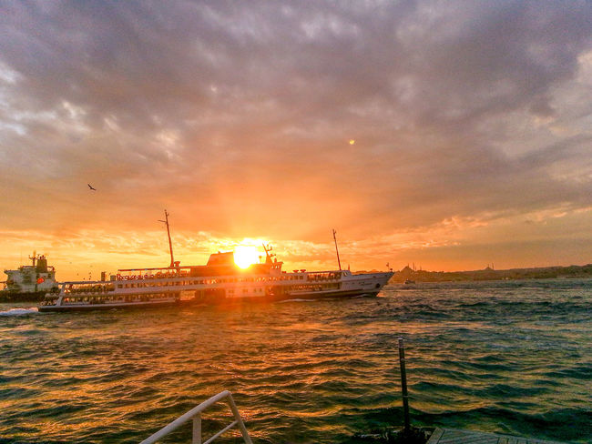 Beauty In Nature Boat Cloud Cloud - Sky Cloudy Idyllic Mast Mode Of Transport Nature Nautical Vessel No People Orange Color Outdoors Rippled Sailboat Scenics Sea Sky Sun Sunbeam Sunlight Sunset 43 Golden Moments Tranquility Water