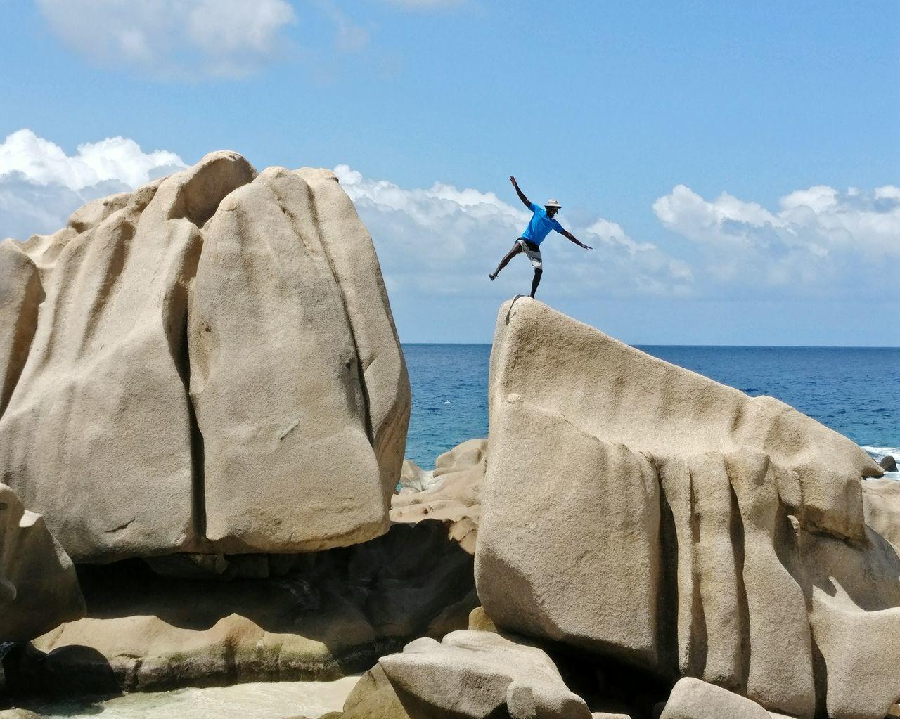 Seychellesisland Seychelles La Digue Scenics Nature Rock Formation Rock - Object Sea Outdoors Carefree Escapism People Of The Oceans People And Places Having Fun Outdoor Activity Outdoor Activities Horizon Over Water Men Ocean Nature