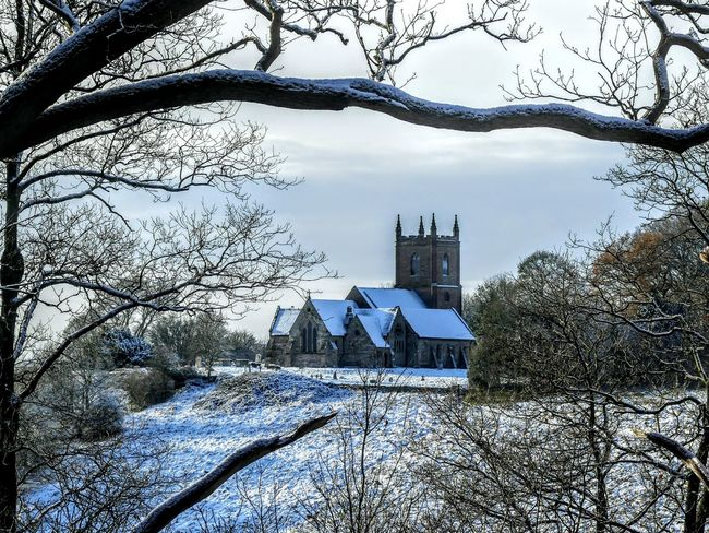 EyeEmNewHere Church Hanbury Church Snow Picturesque Scenery Winter Snow Framed View Tree Building Exterior Architecture Outdoors No People Built Structure Day Branch Sky Nature