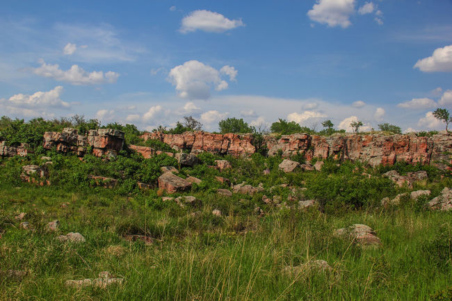 Boulder strewn landscape. Beauty In Nature Blue Sky Boulders Canon60d Canonphotography Cloud EyeEm Gallery Grass Green Landscape Nature Pipestone Pipestone National Monument Rock Formation Rock Outcrop Rocks Sioux Quartzite Sky Stone Summer Tranquility