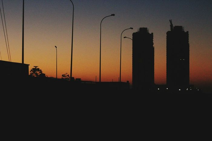 Sunset Silhouette Archival No People City Architecture Skyscraper Outdoors Beachphotography Night Twintowers Second Acts