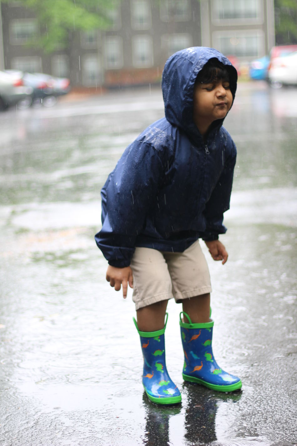 Boys Casual Clothing Childhood Day Focus On Foreground Full Length Lifestyles One Person Outdoors Puddle Real People Road Standing Street Walking Warm Clothing