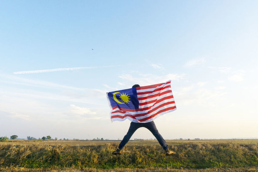 Merdeka Day Celebration Waving Flag Blue Day Field Flag Freedom Grass Landscape Malaysia Nature No People Outdoors Patriotism Pride Sky Stars And Stripes Striped