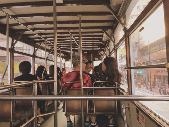 Real People Women Togetherness Lifestyles Indoors  Men Leisure Activity Public Transportation Young Women Young Adult Standing Day Large Group Of People Bonding Friendship Adult People Adults Only