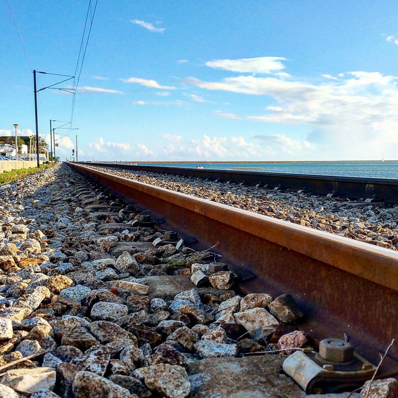 railroad track, rail transportation, sky, transportation, day, cloud - sky, no people, outdoors, nature