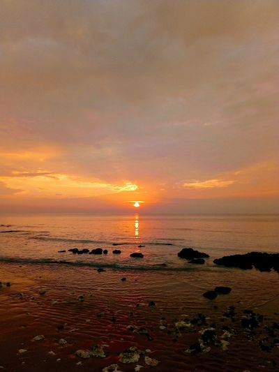 Horizon Over Water Sun Water Reflection Beach Sky Silhouette Dramatic Sky Travel Destinations Vacations No People Red Tourism Outdoors Beauty In Nature Sunlight Cloud - Sky Landscape sea sunrise