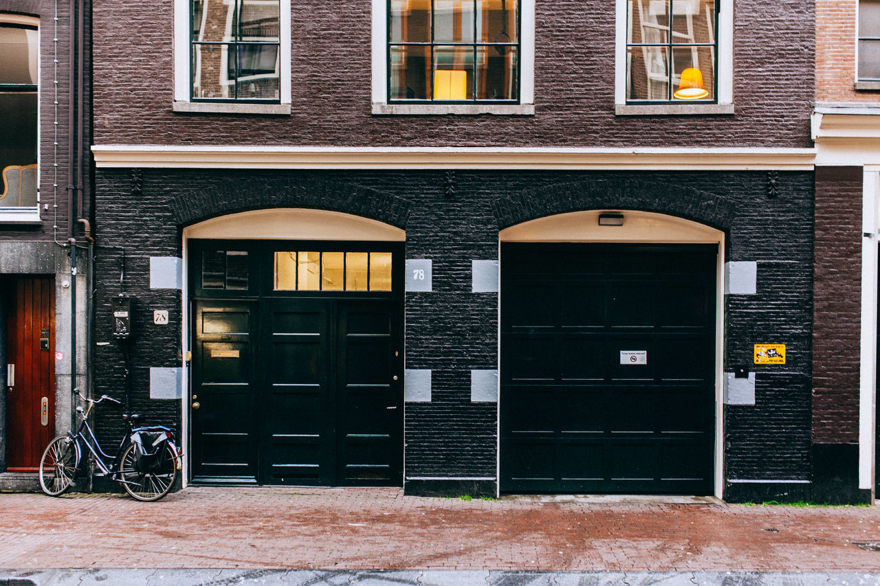 A Wintery Amsterdam... All Streets Amsterdam Architecture Bicycle Brick Wall Building Building Exterior Built Structure City Closed Door Entrance Outdoors Parked Residential Building Residential Structure Sidewalk Street Street Light Transportation Window Yellow Your Amsterdam