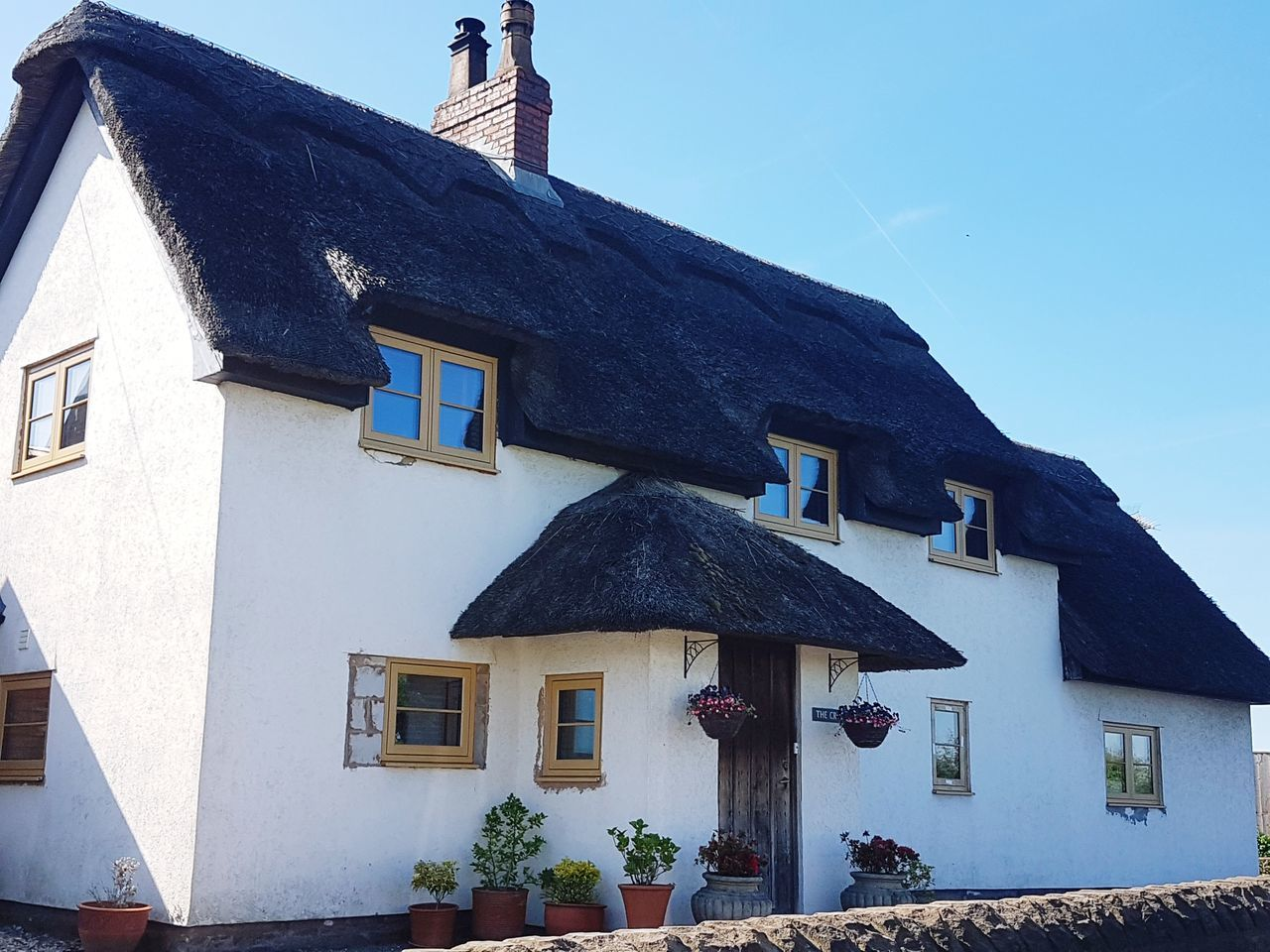 Thatched Roof Thatched Cottage Country Cottage Thatched House White House White Houses In Landscape Architecture House Building Exterior Built Structure Outdoors Roof No People Sky Blue Sky Clear Sky Beautiful Spring Day Beautiful Day Shadows & Lights Shadow And Light Day