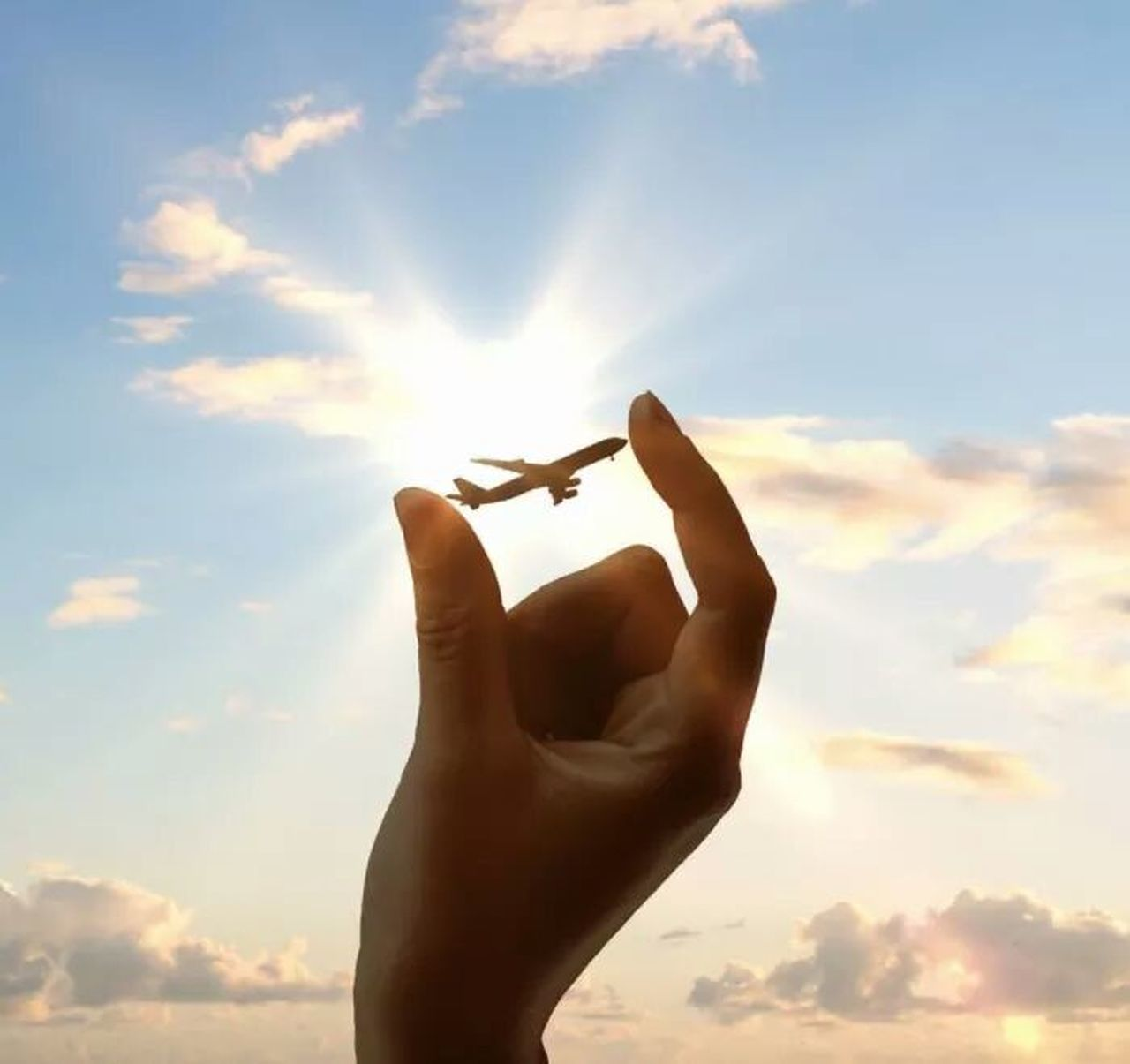sky, cloud - sky, flying, human hand, one person, silhouette, human body part, real people, outdoors, sunlight, low angle view, day, airplane, nature, close-up, people