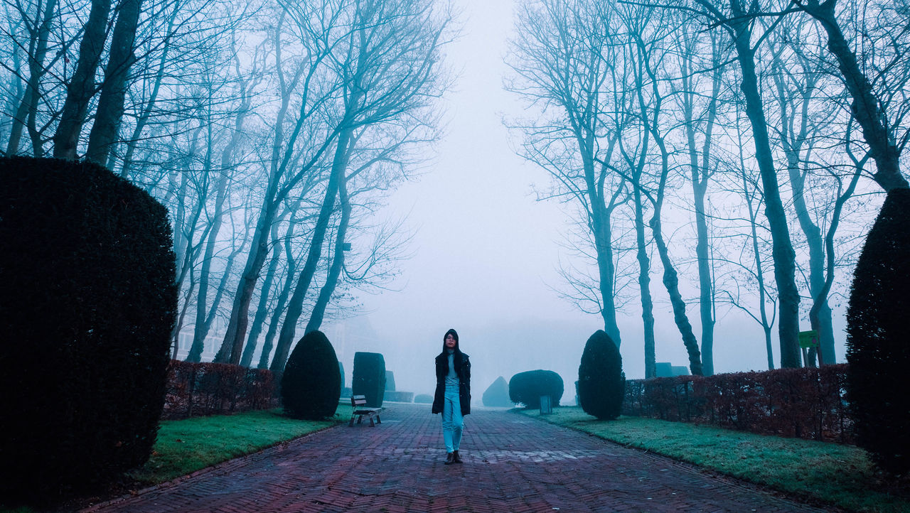 Beauty In Nature Cold Day Fog Forest Full Length Leisure Activity Nature One Person Outdoors Park People Sky Standing Street Fashion Streetart Streetphotography Tree Women