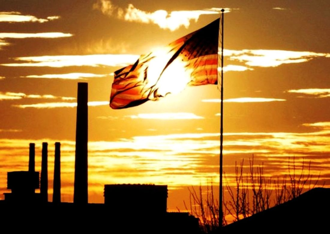 One of the first photos I took with a dslr. This is one of the views from my bedroom window. The sun was perfectly centered behind the flag, making it look like it burned a hole through it. With the power plant in the background, it's like a symbol for the impact of industrial pollution. 43 Golden Moments Flag Sun