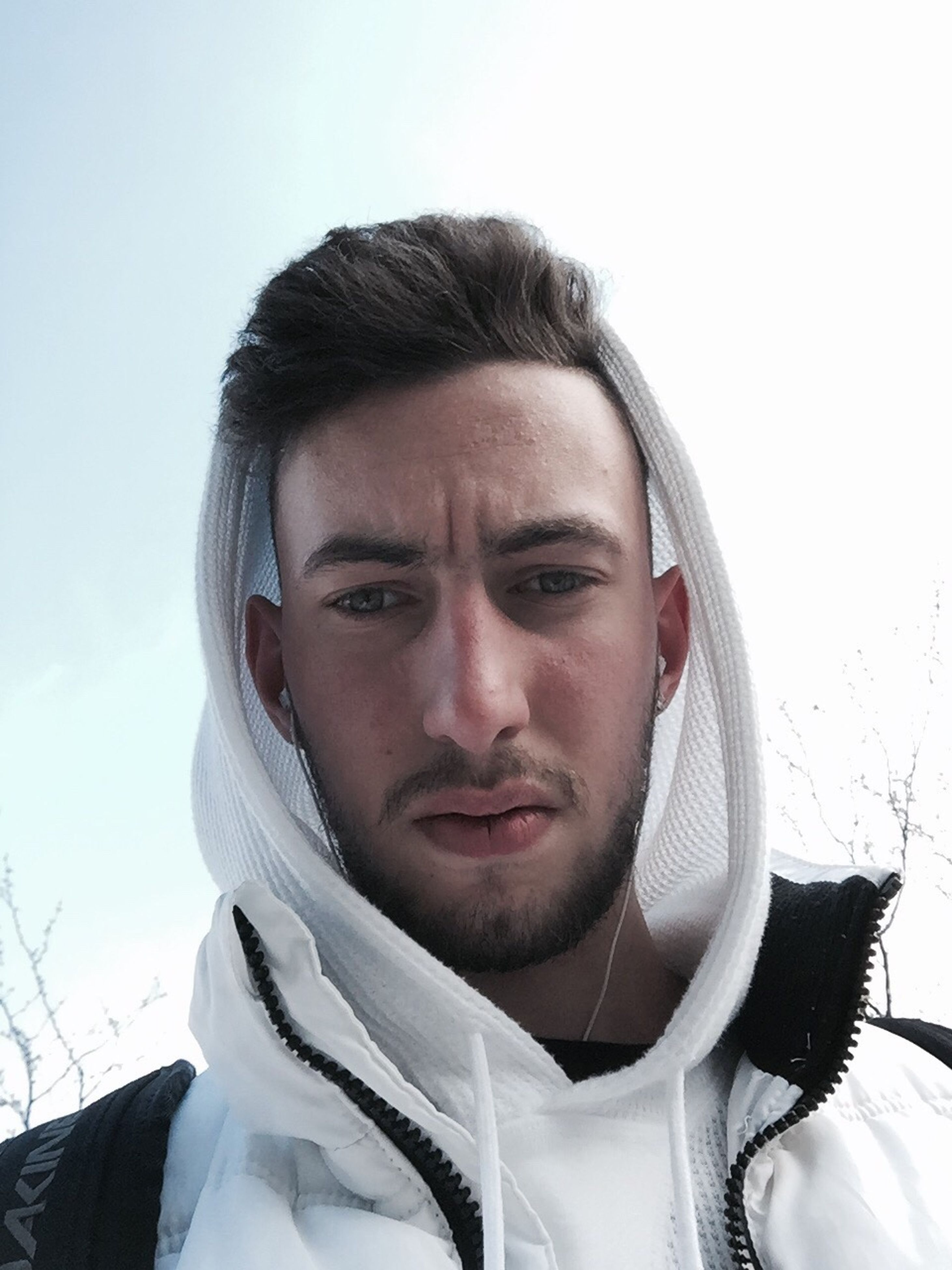 real people, front view, young adult, headshot, lifestyles, young men, leisure activity, head and shoulders, one person, day, looking at camera, portrait, winter, outdoors, close-up, beard, sky, young women, warm clothing