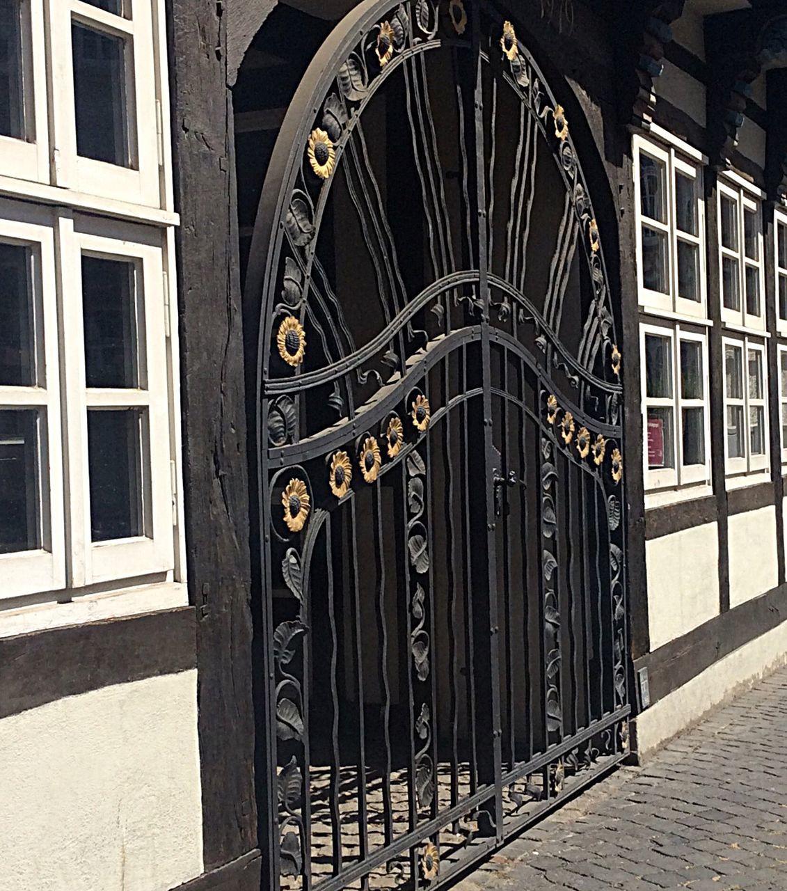 Sidewalk By Arch Gate Of House