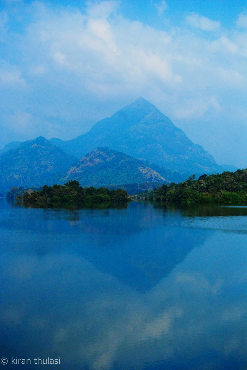 mountain, tranquil scene, reflection, scenics, sky, beauty in nature, water, lake, tranquility, outdoors, mountain range, nature, no people, waterfront, day, tree